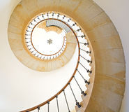 Spiral staircase. Bottom view of lighthouse spiral staircase stock photo