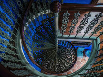 Spiral Staircase in Chinese Mansion. Looking down a spiral staircase in an old chinese mansion Stock Photo