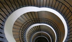Spiral stairs perspective. Spiral staircase with curve shape diminishing perspective, high angle view Royalty Free Stock Photo