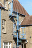Spiral staircase fire escape outside property Stock Images