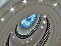 Spiral staircase with glass atrium royalty free stock photography