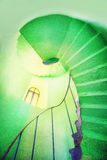 A spiral staircase in the green lighthouse Stock Photos