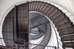 Spiral staircase inside the Hunting Island Lighthouse in South Carolina. White walls royalty free stock photo