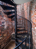 Spiral staircase inside of an  old lighthouse. Spiral staircase inside of an old lighthouse Stock Photo