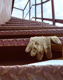 Spiral staircase of iron , and glove Royalty Free Stock Photo