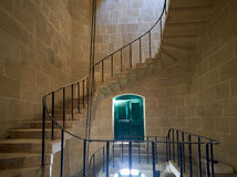 The spiral staircase in the Malta Maritime Museum in Vittoriosa. Kalkara, MALTA - JULY 24, 2015:  The spiral staircase in the Malta Maritime Museum (Old Naval Royalty Free Stock Photos