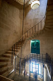 The spiral staircase in the Malta Maritime Museum in Vittoriosa. Kalkara, MALTA - JULY 24, 2015: The spiral staircase in the Malta Maritime Museum (Old Naval Stock Photo