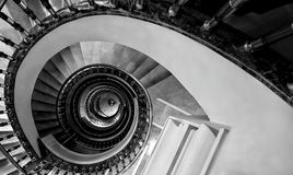 Spiral Staircase. Monochrome photo of a spiral staircase. Taken according to the rules of aesthetics such as golden ratio and golden spiral royalty free stock photo