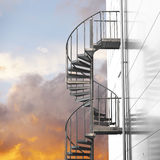 Spiral staircase on orange sky Royalty Free Stock Images