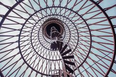 Spiral staircase of rusty abandoned water tower. First hyperboloid of engineer Shukhovl Stock Photo