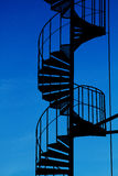 Spiral staircase silhouette. Spiral staircase silhouette and blue sky royalty free stock image
