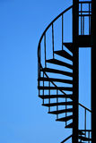 Spiral staircase. Silhouette isolated on blue sky Stock Photos