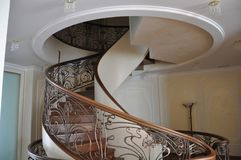 Stairs in a modern style. Wonderful work and home decoration. This spiral staircase is simply a masterpiece of modern design, the exact execution of an Stock Photography
