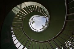 Spiral staircase and sky. The design of this spiral staircase creates an interesting pattern against the daytime sky Royalty Free Stock Photos