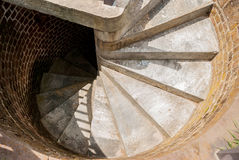 Spiral Staircase. Tight concrete steps work up a spiral staircase to the top of a lighthouse stock photo
