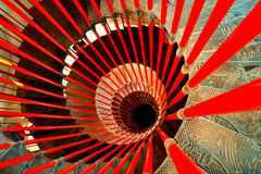 Spiral staircase. On the top of a red metal spiral staircase stock images