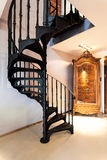 Spiral staircase and a wardrobe. Metal spiral staircase and old fashioned wardrobe Stock Photos