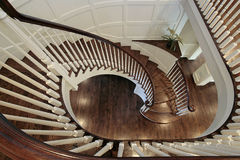 Spiral staircase with wood railing stock photography
