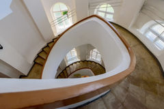 Spiral staircase with yellow banisters and white walls. In the museum of the city of Vladimir royalty free stock photo
