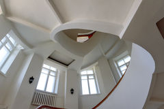 Spiral staircase with yellow banisters and white walls. In the museum of the city of Vladimir royalty free stock photos