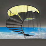 Spiral staircase with yellow flare and blue sky view Royalty Free Stock Photography