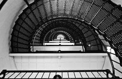 Spiral stairs. Endless spiral staircase photo shot in black and white Stock Photo
