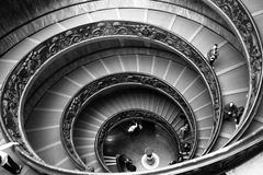 Black and white Vatican stairs. Black and white shot of ornate Spiral Stairs inside the Vatican Museum in Rome, Italy Stock Image