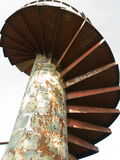 Spiral stairs. An abstract view of old rusted structure of spiral stairs from below Royalty Free Stock Photos