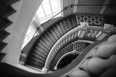 Spiral stairs with balusters monochrome fragment. Spiral stairs with balusters. Abstract classical architecture dark interior monochrome fragment Stock Photography