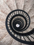 Spiral stairs with black balustrade Royalty Free Stock Images