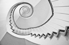 Spiral stairs black and white. Black and white spiral stairs from below Royalty Free Stock Image