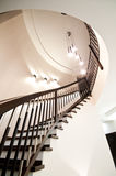Spiral stairs. Elegant home interior with spiral wooden stairs stock images