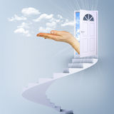Spiral stairs and magic doors with hand Stock Image