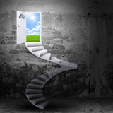Spiral stairs and magic doors. Leading to a landscape Royalty Free Stock Image