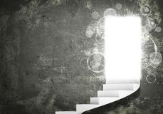 Spiral stairs and magic doors. Leading to a light Stock Images