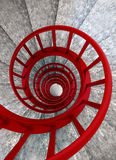 Spiral stairs with red balustrade. Spiral stone stairs with red painted balustrade, view from top Royalty Free Stock Images