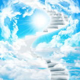 Spiral stairs in sky with clouds and sun Stock Photography