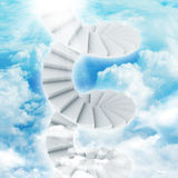 Spiral stairs in sky with clouds and sun Royalty Free Stock Photography