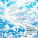 Spiral stairs in sky with clouds and sun Royalty Free Stock Photos
