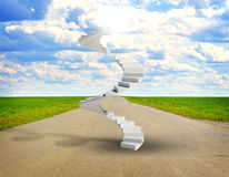 Spiral stairs in sky with green grass, road and Stock Photography
