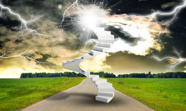 Spiral stairs in sky with green grass, road and Royalty Free Stock Photo