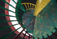 Spiral stairs and slide Stock Image