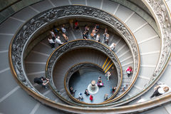 Spiral stairs. VATICAN - APRIL 15: Spiral stairs, tourist are walking down spiral stairs in Vatican Museums on April 15, 2015 in Vatican. Vatican City is the Stock Photos