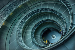 Spiral stairs in Vatican. Old spiral stairs in Vatican Museums Royalty Free Stock Photo