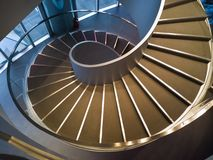 Spiral stairs. Wide-angle view down a spiral stairs from the high point Stock Photos