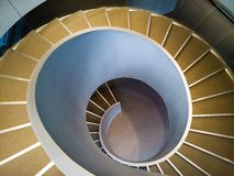 Spiral stairs. Wide-angle view down a spiral stairs from the high point Royalty Free Stock Photos