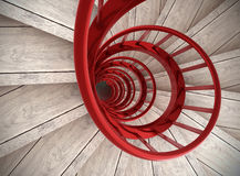 Spiral stairs. Spiral wood stairs with red painted balustrade Stock Images