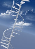 Spiral stairway upwards to success. Spiral staircase reaching upwards towards the clouds as achievement Royalty Free Stock Photography