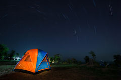 Spiral star trail with colorful tent Stock Images