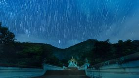 Star trail on temple in night time. Spiral star trail on temple stock footage